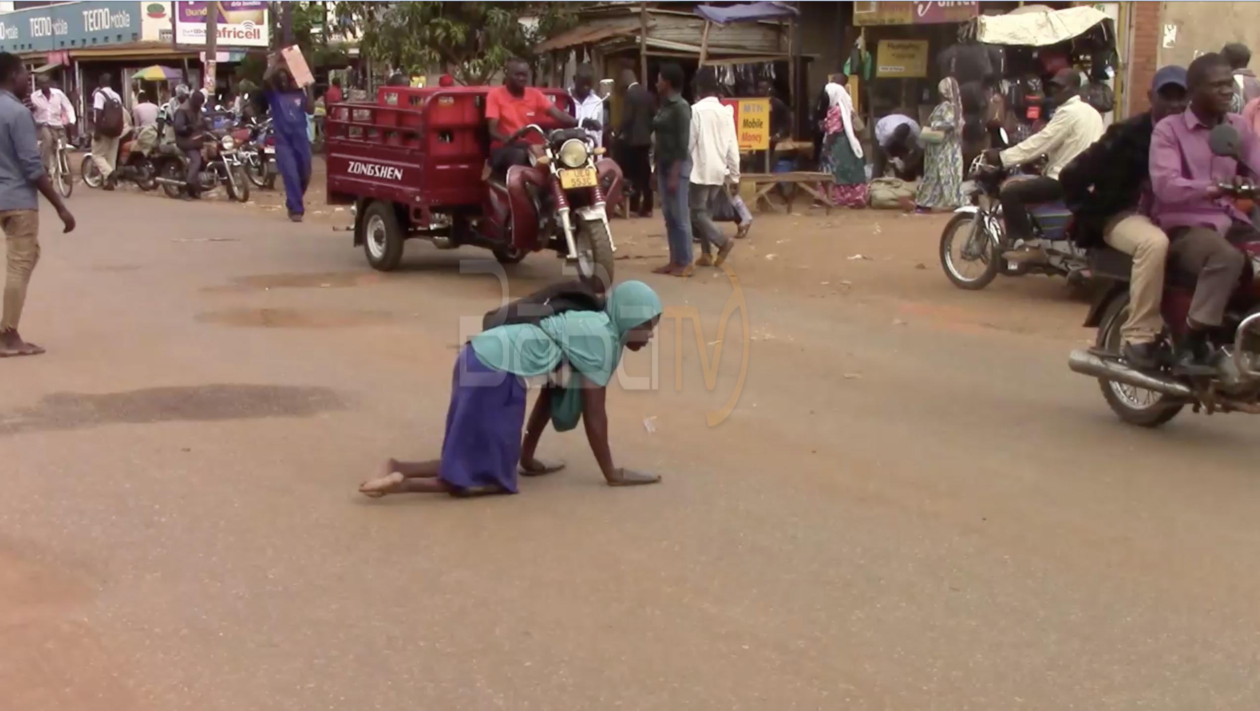 Kamuyati crossing the busy Iganga-Malaba highway